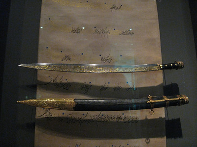 Turkish sword and scabbard 14th century.  Steel with gold inlay.