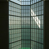 The 45 meter atrium window looks out onto Doha Bay and the skyline. Museum of Islamic Art, Doha, Qatar.