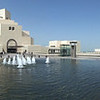 An angular pool with fountains announces the entrance concourse. Museum of Islamic Art, Doha, Qatar.