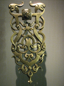 One of a pair of brass door knockers, 12th century.