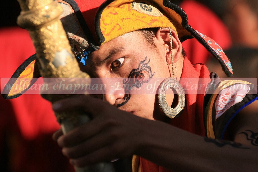 Dancer at the Teej Festival in LoMantang. He is dancing to expel demons from the city
