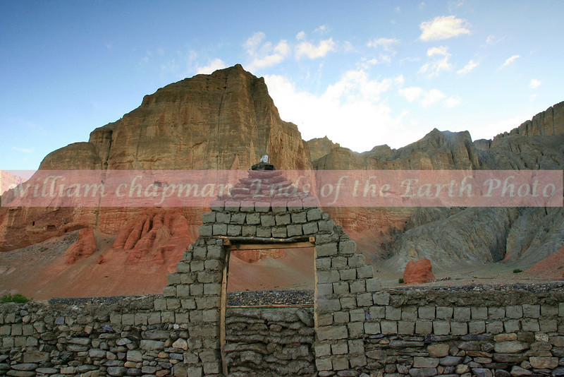 Drakmar Village with red bluffs in Upper Mustang