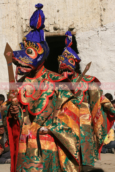 Masked Dancers enter the fesival on opening day in LoMantang