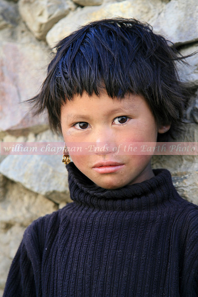 Child of Mustang outside monastery in Upper Mustang