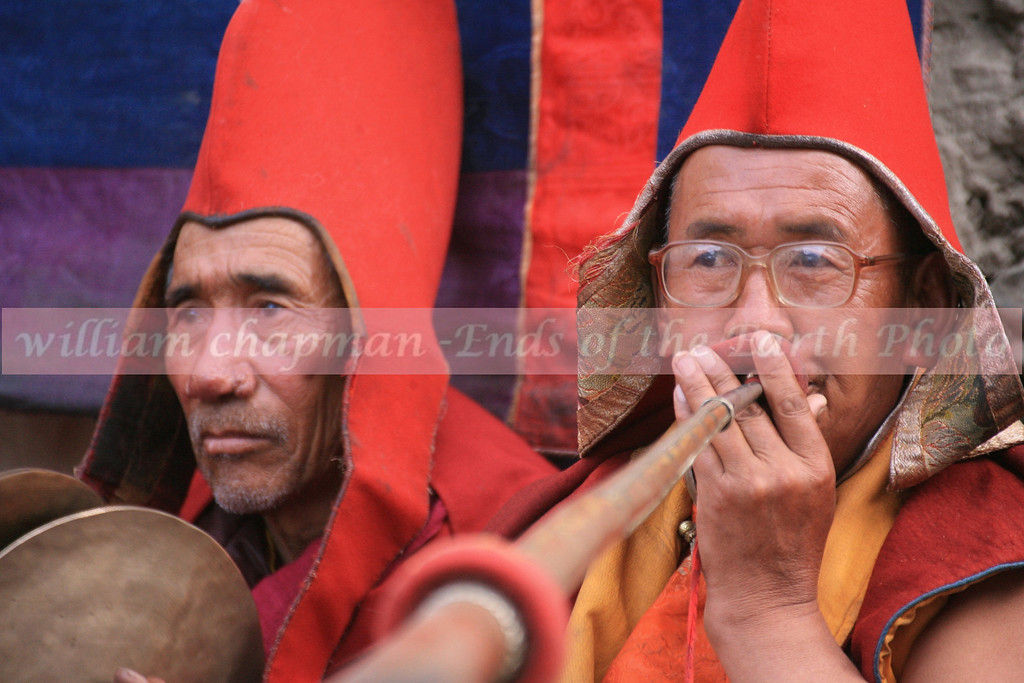 A musician plays a traditional Tibetan long trumpet during Teej Festival, Mustang