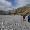 Eric and Pemba walking toward Chele. The riverbed here is full of Ammonite fossils.