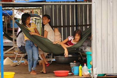 Vietnamese girls at home, afloat on the Mekong River, Muy Tho.