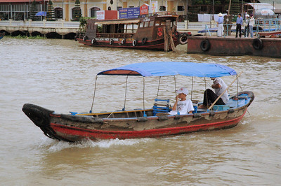 Homeward bound, across the Mekong River, Muy Tho, Viet Nam.