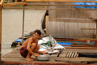 Cleaning up at home, Mekong River, near Muy Tho.