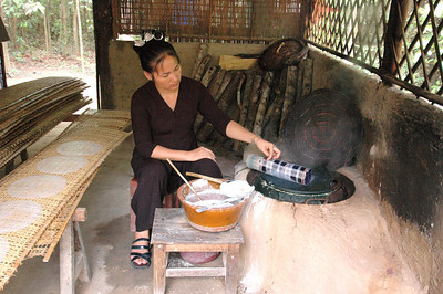 Preparing rice pancakes, near Cu Chi, southern Viet Nam