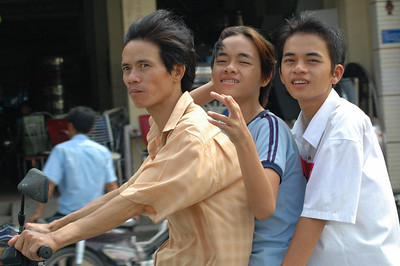 Three on a motor scooter, Saigon
