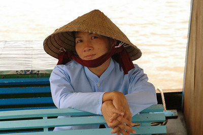 Tourist boat captain's wife, Mekong Delta, Muy Tho.