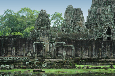 Face towers dominate the ruins of the Bayon temple in the ancient Khmer capital of Angkor Thom (12th-17th century AD).