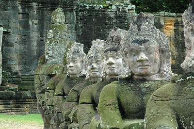 "Across the entrance causeway to the ancient Khmer capital of Angkor Thom from a similarly situated from of devas -- ""good"" deities -- are arrayed these Asuras, or demons."