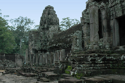 Outer walls and tower detail of the Bayon temple within the ancient Khmer capital of Angkor Thom.