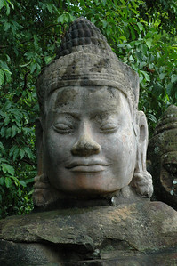 The Hindu devas, of which this is a representation of one, roughly parallel the Greek and Roman pantheon, in terms of scope and intent. Outside the ancient Khmer capital of Angkor Thom.