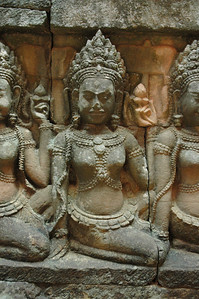 Traditional Khmer dancers, or apsara, grace a wall in Angkor Thom, Cambodia.