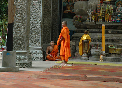 Buddhist monks at a modern temple inside the Angkor Thom complex, Cambodia.