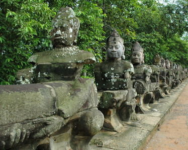 Statues of devas -- gods or supernatural beings -- line a causeway crossing the moat surrounding the ancient Khmer capital of Angkor Thom.