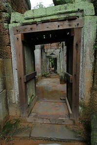 Passages through Ta Phrom temple ruins, Angkor, Cambodia.
