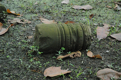 Portion of column, among vast fields of rubble, inside the ancient Khmer capital of Angkor Thom.