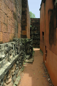 Narrow passage between two structures of significantly different age, at Angkor Thom, Cambodia.