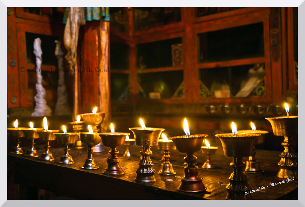 Ceremonial lamps lit inside the Langza Monastery, Spiti Valley (Himachal Pradesh)