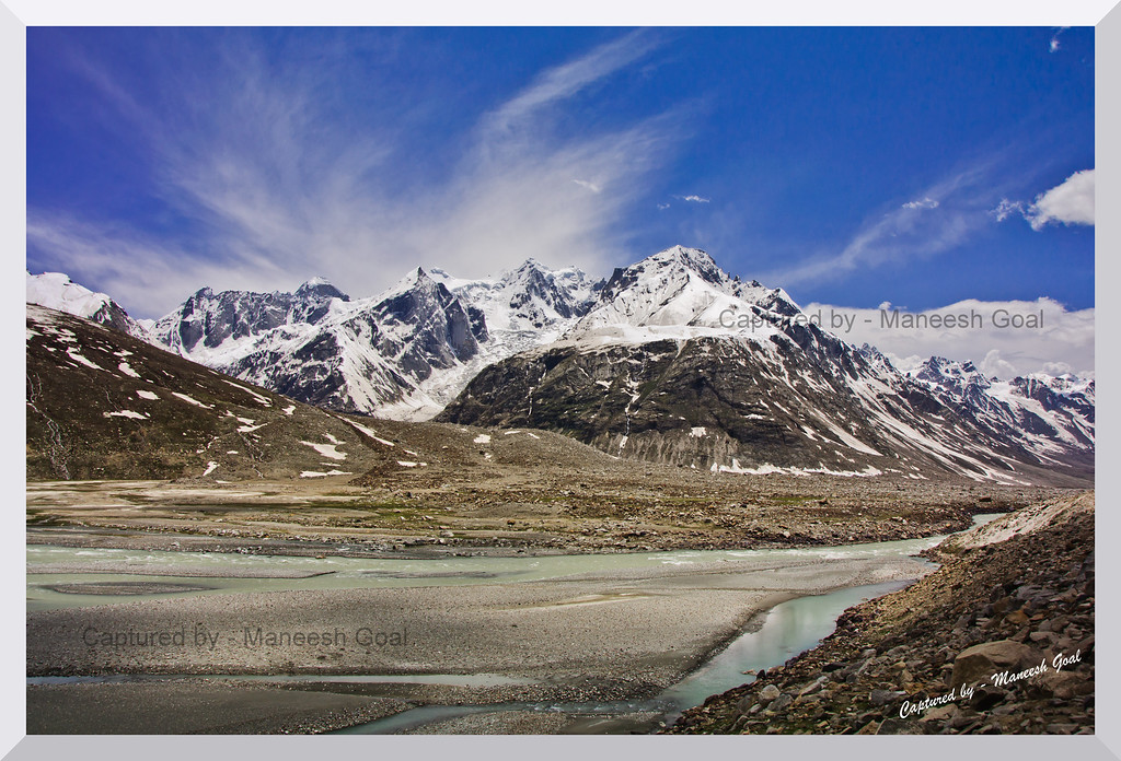 Chandra River with the glacier in background and surrounded by glacier melt - en route to Manali from Spiti Valley (Himachal Pradesh)