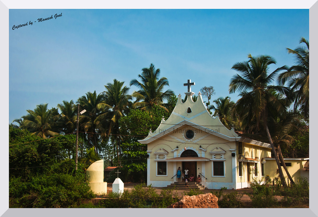 A family waits for the Church to open on Easter day (en route Margao from Ponda)