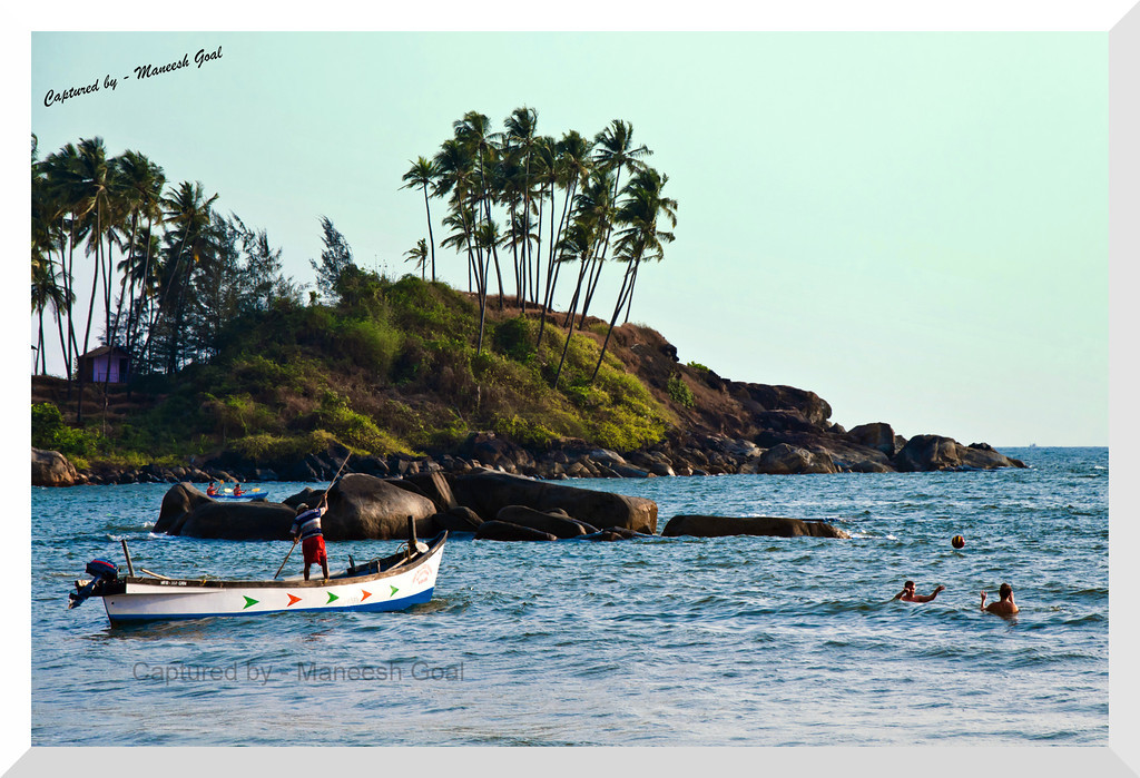 Two different worlds @ Essentially Goa - fisherman and tourists share the same space! Palolem Beach