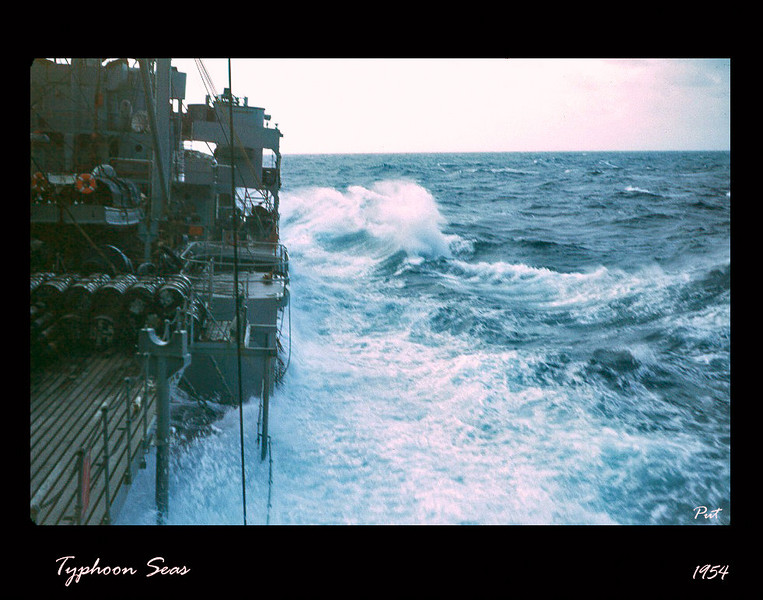 We (USS Tolovana AO-64) are riding out a typhoon in the South China Seas.  This shows waves completely swamping the well deck,  These conditions persisted for several days.