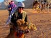 Thnaking my camle for the lovely desert ride in to camp in Wadi Rum, Jordan.