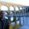 Ralph is in France  (Pont du Gard) with the popular Roman bridge aqueduct in the background built between 40 - 60 AD and crosses the Gardon River.