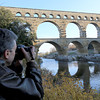 Ralph is in France (Port Du Gard) taking a picture of the popular Roman bridge-aqueduct in the background built between 1842 and 1846.