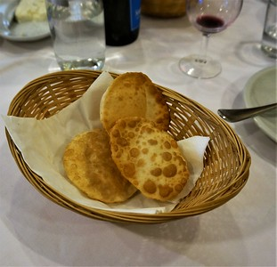 Next course, crescentini  Little puffy, fried breads  To fill with
