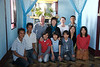 Craig and Jeane with guide Joyce and family in front of the Buddhist shrine in their Taunggyi home