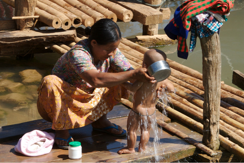 Lady bathing her baby at Indein - Inle Lake