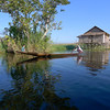 Inle Lake with a house on stilts in the background. by Judi