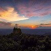 Sunset overlooking Mt. Popa, a holy shrine dedicated to the Nat spirits. by Jook