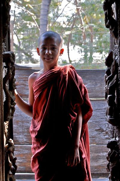 Monk novice in dorway
