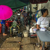 Street-side vendors (and wonky pavement) in Yangon