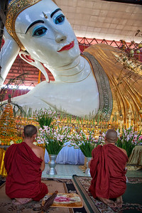 Praying to Reclining Buddha at Chaukhtatgyi Paya, Yangon