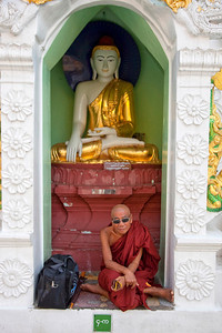 Buddhist Monk at Young at Shwedagon Paya in Yangon