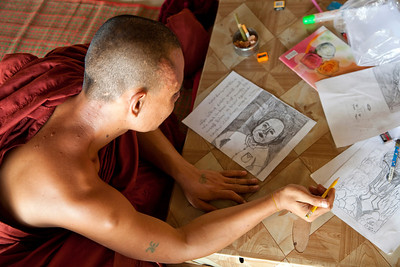 Monk drawing at Reclining Buddha at Chaukhtatgyi Paya, Yangon