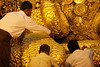 Adding Gold Leaf to Buddha Statue in Honor of the New Monk