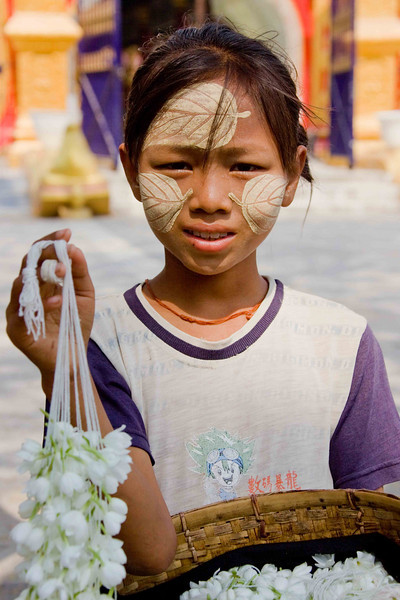 """Flower Seller at """"World's Biggest Book"""" Temple. Note intricate detail in makeup."""