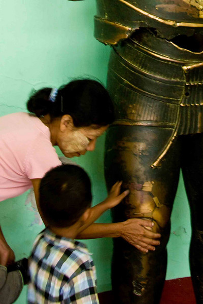 Rubbing Ancient Statue for Good Luck