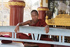 """Monk at """"World's Biggest Book"""" Temple"""
