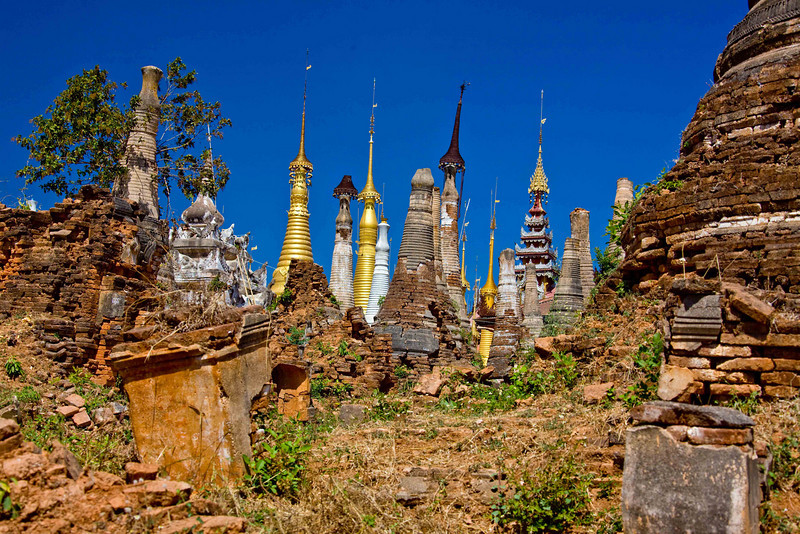 Thaung Tho Kyaung Stupas Including a Couple Being Restored