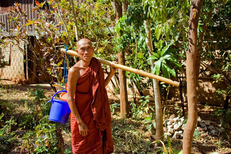 A Monk Shwe Yaunghwe Kyaung Monastery Near Inle Lake